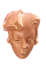Two Goldscheider wall masks with another circa 1937 and 1960