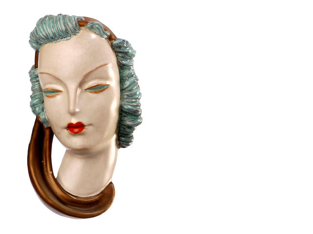 Two Goldscheider terracotta masks of women 1938 and 1939