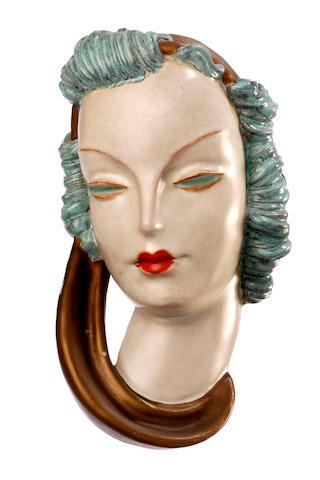 Two Goldscheider terracotta masks of women 1938 and 1939