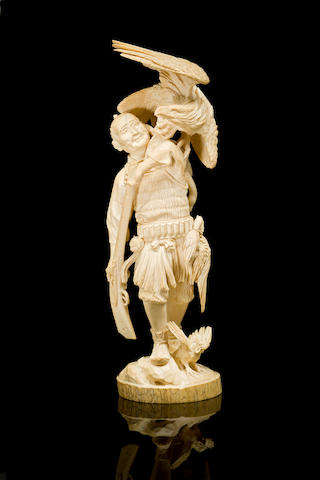 A large Japanese carved ivory figure of a hunter Meiji Period