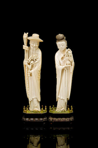 A pair of Chinese carved ivory figures 19th century