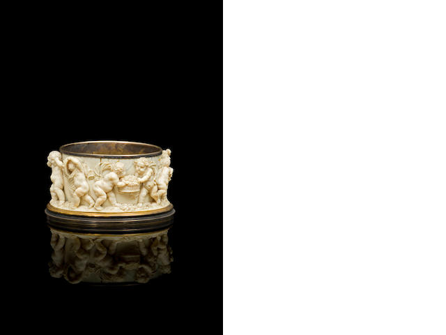 A German 18th century carved ivory and brass dish