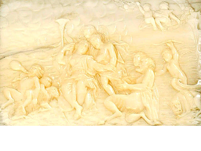 An 18th century carved ivory panel in a leather case