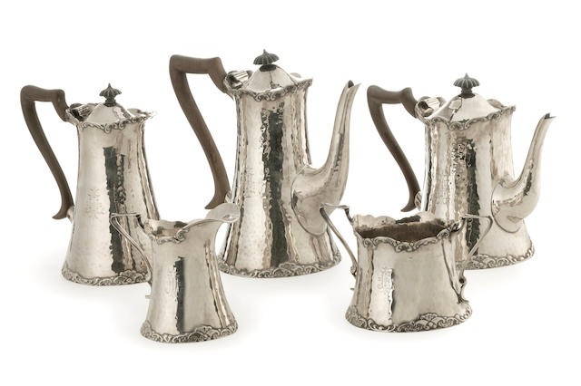 An Edwardian hand beaten silver five piece tea and coffee service CE London 1905  (5)