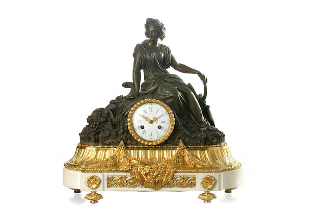 A 19th century French patinated and gilt bronze figural mantel clock Movement by Roblin A Paris
