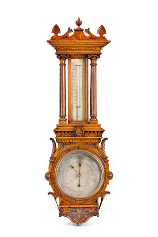 A good late Victorian oak cased barometer retailed by H. Sherratt, Manchester