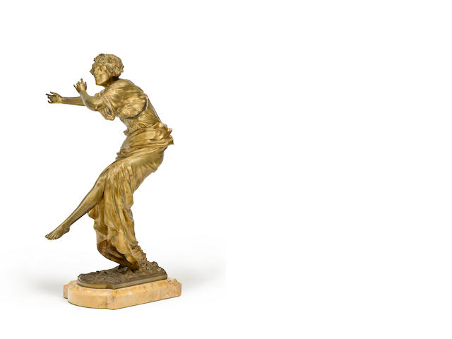 A French Art Deco gilt bronze figure of a flute girl possibly by P. Philippe