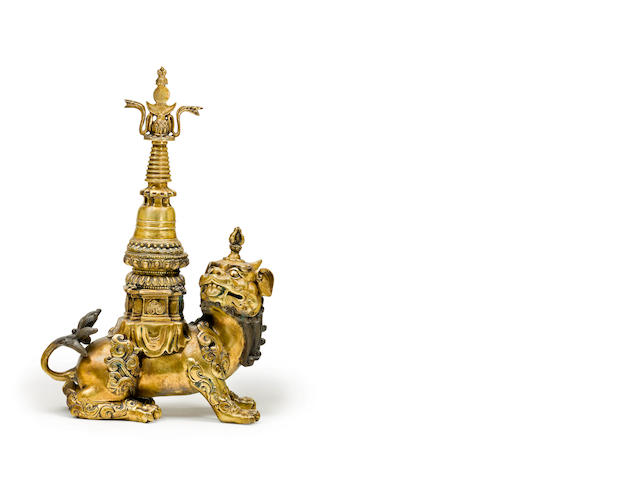 A gilt-bronze Tibetan mythical beast carrying a stupa 18th/ 19th century
