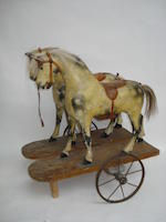 Pair of painted wooden horses