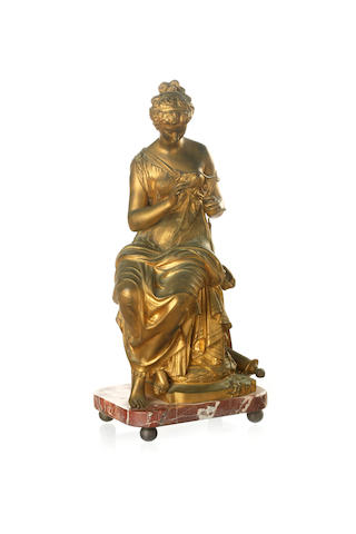 A Victorian gilt bronze figure of a seated woman