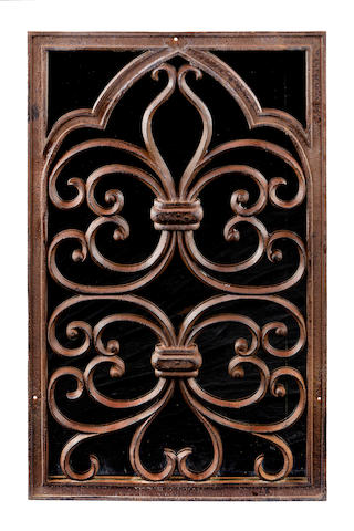 A decorative cast iron window panel