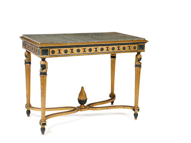 An ebonised and gilt centre table with a marble top