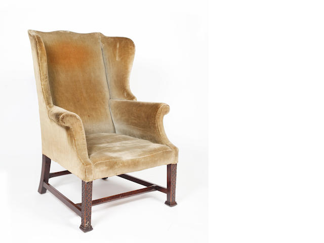 A late Georgian wingback armchair,