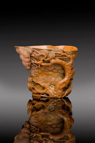 A Chinese finely carved bamboo libation cup 17th/ 18th century