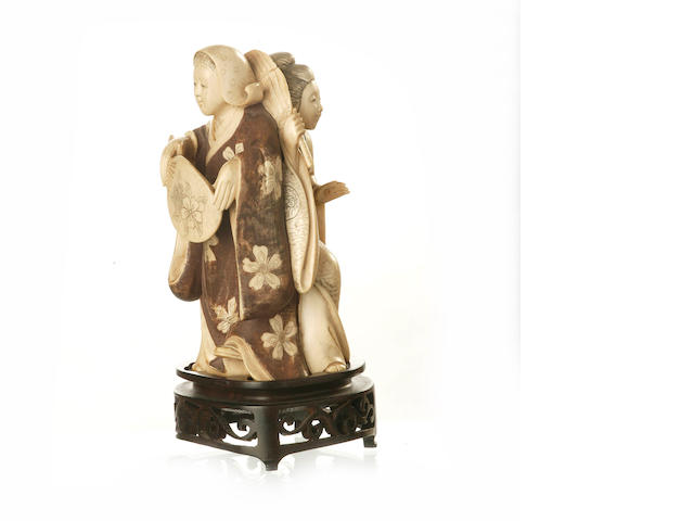 A carved and tinted Japanese ivory of two ladies 20th century