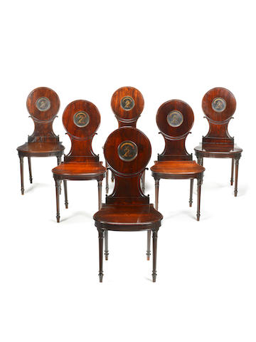 A set of six George III mahogany hall chairs by Gillow