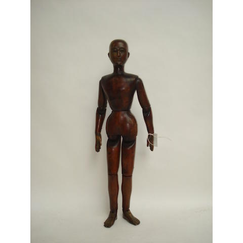 A large stained and carved wooden articulated lay figure, probably late 19th century