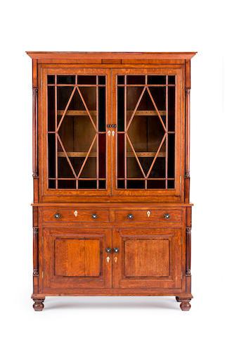 A late George III oak and mahogany bookcase