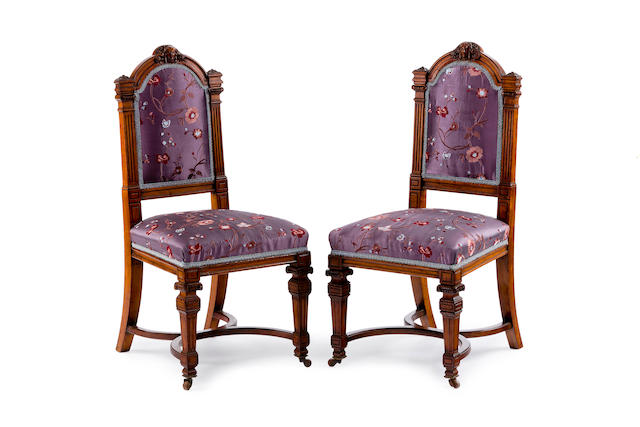 A pair of Victorian mahogany and upholstered chairs by Gillow