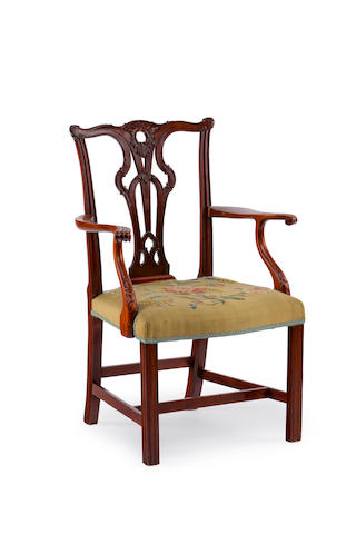 A George III mahogany armchair with tapestry seat