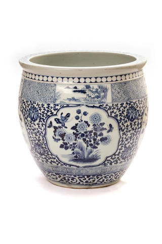 A large Chinese blue and white fish bowl on a stand 19th/ 20th century
