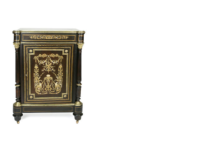A late 19th century French ebonised and brass inlaid cabinet