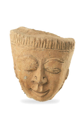 A South East Asian carved sandstone head of a man