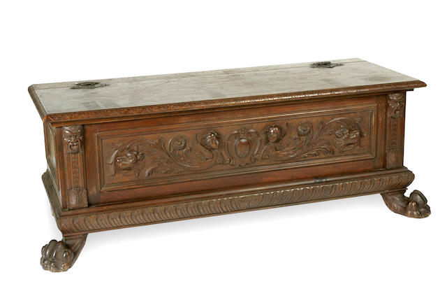 A late 19 century Italian Renaissance style walnut and pine carved cassone