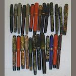 A collection of twenty six vintage Parker Duofold, Moderne, Vacumatie and other fountain pens in a niceday black display briefcase type carrying case.