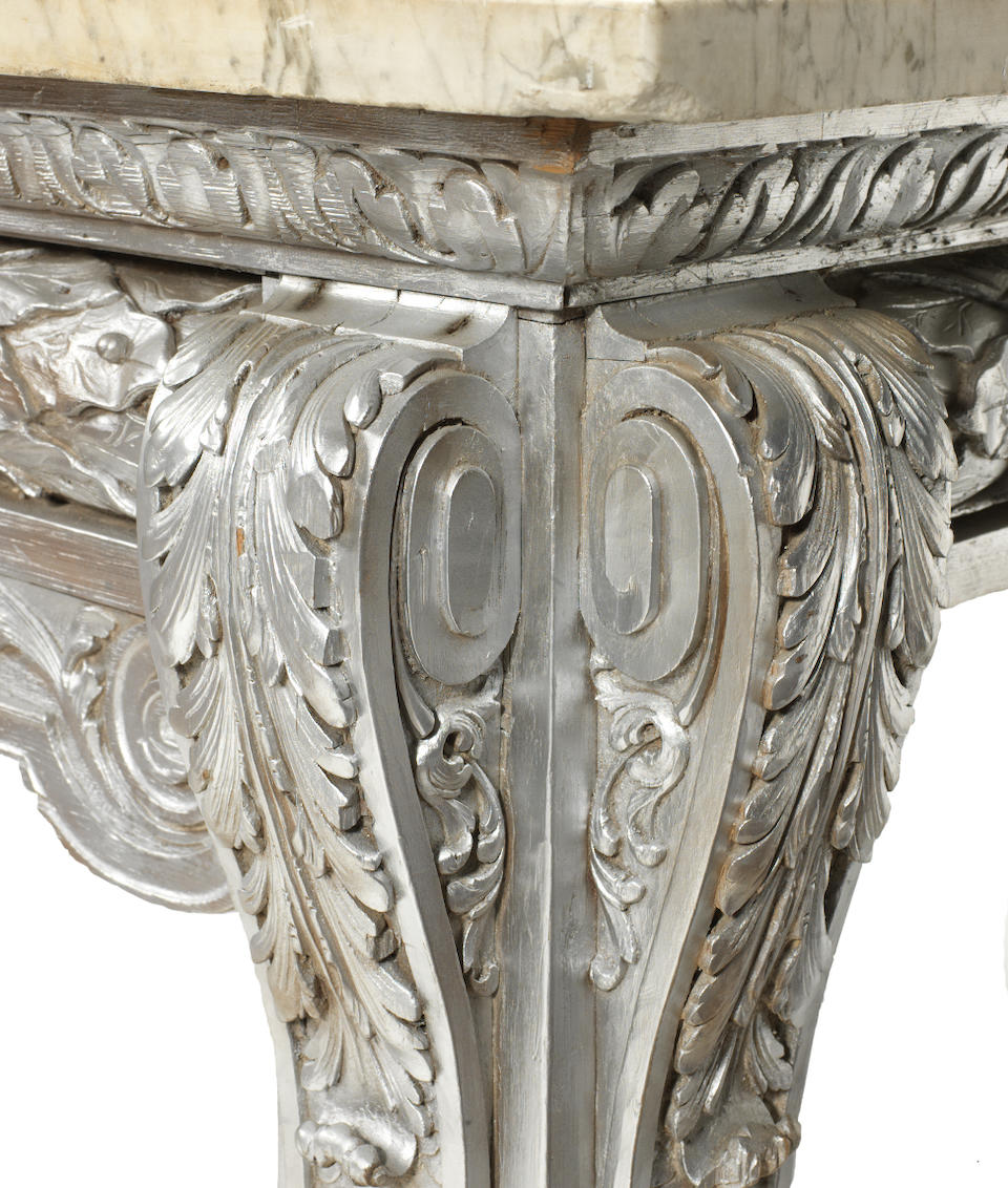 A large carved pine and silver painted side table in the George II style, after Matthias Lock