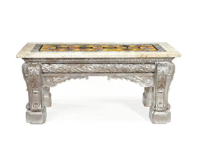 A George II carved pine later silver painted side table in the manner of Matthias Lock and possibly attributable to Henry Flitcroft