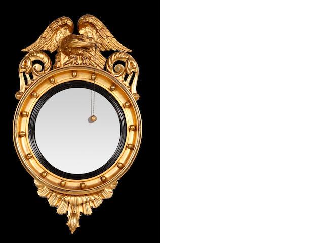 A Regency giltwood convex mirror