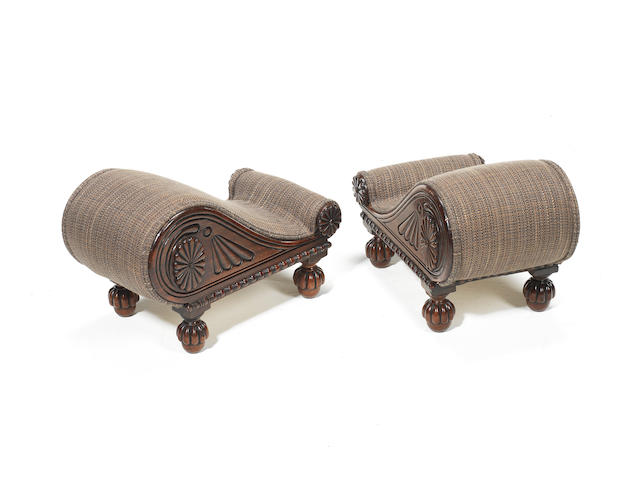 A pair of Regency carved mahogany footstools  after a design published by Ackermann