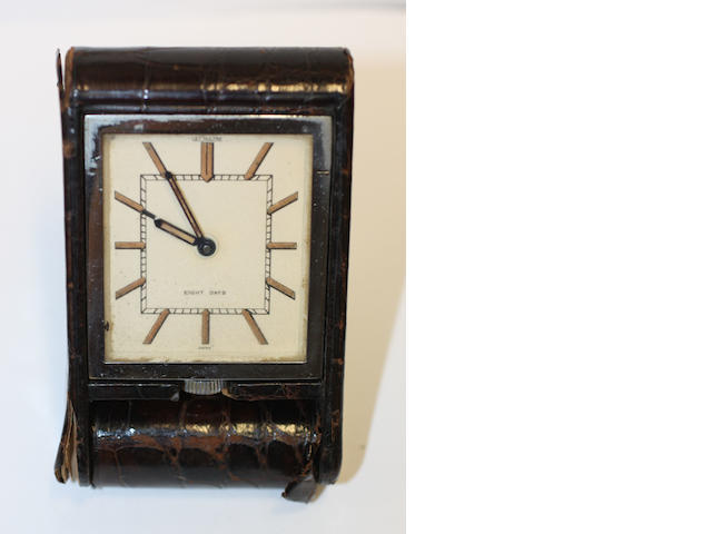 A LeCoultre 8 Day leather covered alarm travel clock
