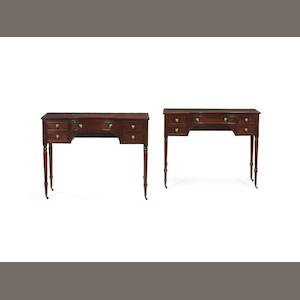 A matched pair of George IV mahogany concave fronted dressing tables  in the manner of Gillows