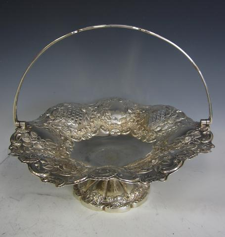 An Edwardian silver circular swing-handled basket, by J.T. Sheffield 1905,