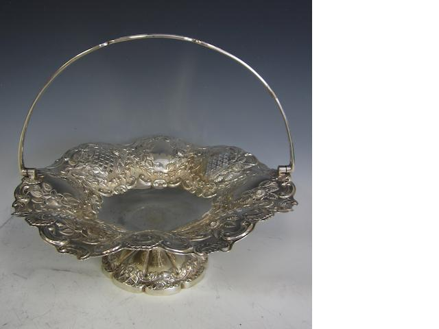 An Edwardian silver circular swing handled basket,  by J.T. Sheffield 1905,