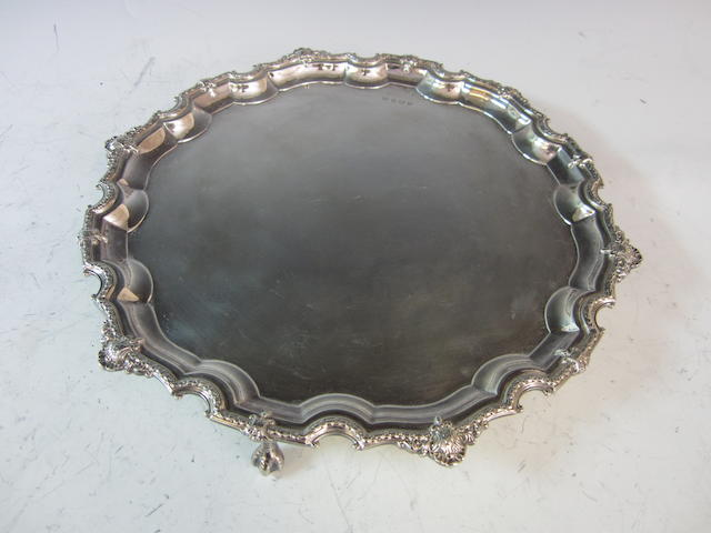 A silver circular salver,   by Poston Products Ltd,   Sheffield 1964,