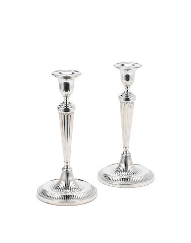A pair of George III silver candlesticks by Richard Carter, Daniel Smith & Robert Sharpe, of London, Sheffield 1786