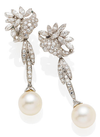 A double-strand cultured pearl necklace and a pair of pendent earrings