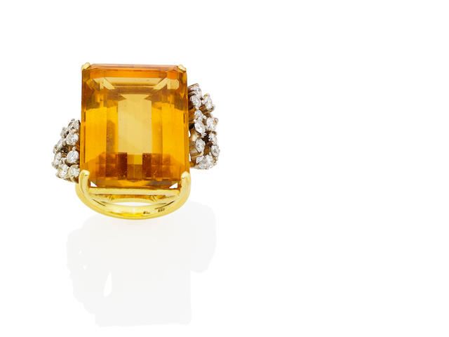 A citrine and diamond cocktail ring