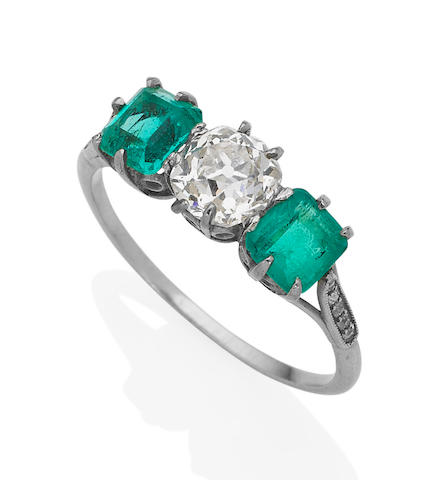 An early 20th century emerald and diamond three-stone ring,