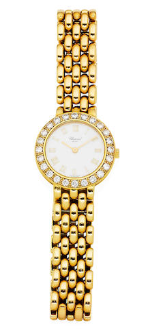 An 18 carat gold lady's diamond-set bracelet watch, by Chopard