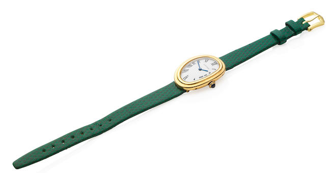 An 18 carat gold lady's 'Baignoire' wristwatch, by Cartier