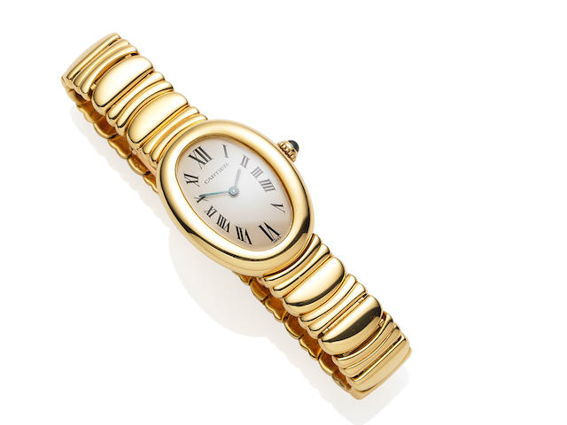An 18 carat gold lady's 'Bagnoire' wristwatch, by Cartier
