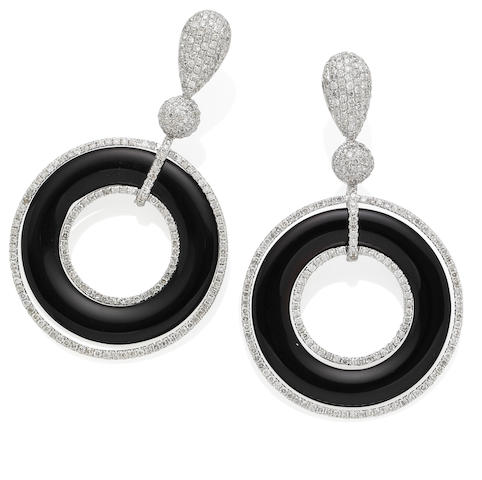 A pair of onyx and diamond pendent earrings