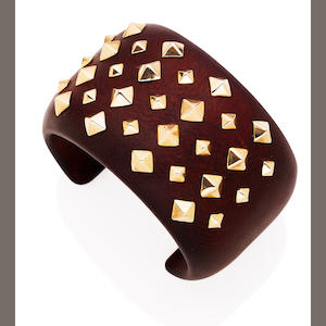 A gold and wood cuff
