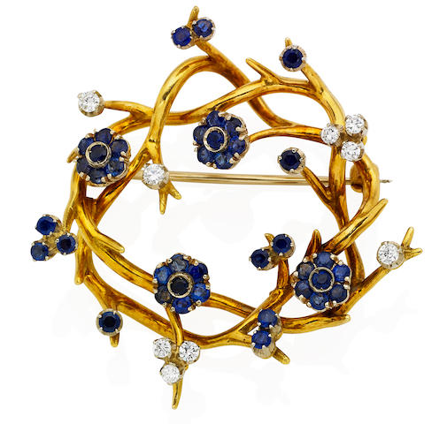 A sapphire and diamond brooch,  by Tiffany & Co.