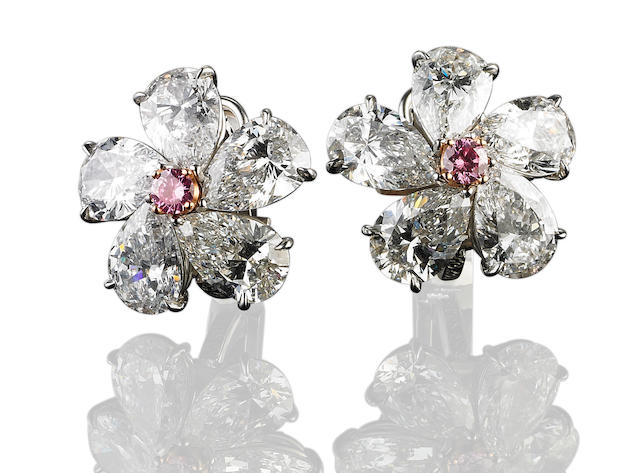 A pair of diamond and coloured diamond cluster earrings