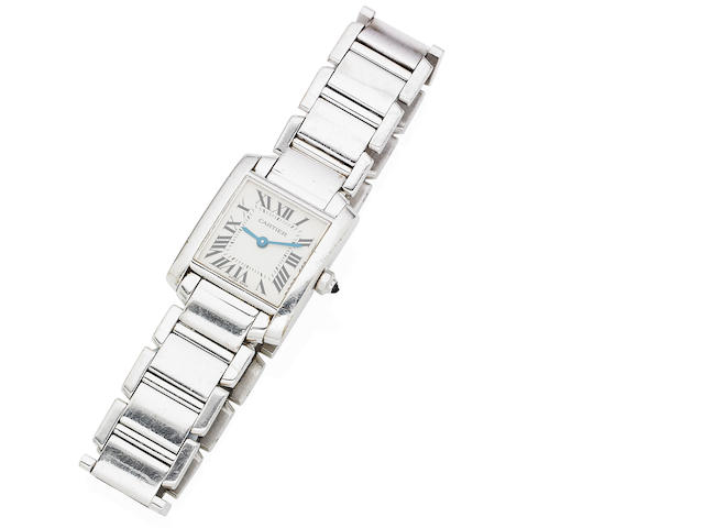 An 18 carat white gold lady's 'Tank Francaise' bracelet watch,  by Cartier
